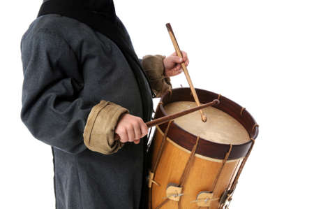 Drummer boy playing over a white background Stock Photo - 7898337