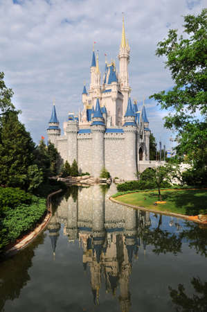 disney: Disney Castle in Orlando, Florida with reflections on the water Editorial