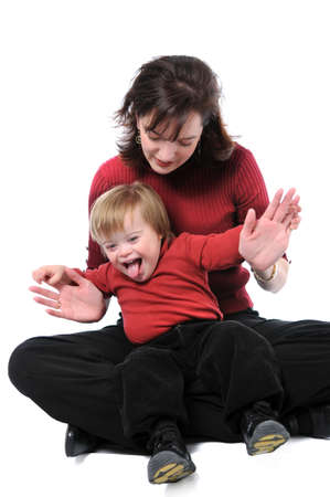 Mother and child with Down Syndrome playing Stock Photo - 7887467