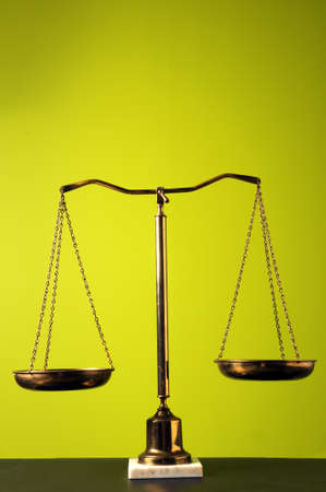 Scales over a bright green background photo
