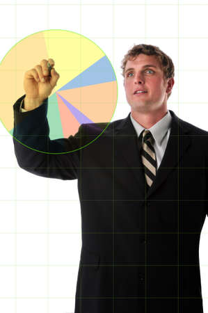 charting: Businessman charting a color graphic over electronic board Stock Photo