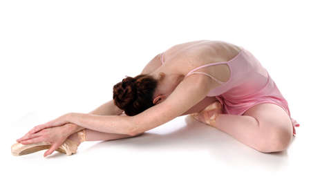 ballet slippers: Ballet dancer laying on floor over a white background