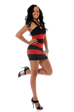 american sexy: Young African American woman in red and black dress smiling Stock Photo