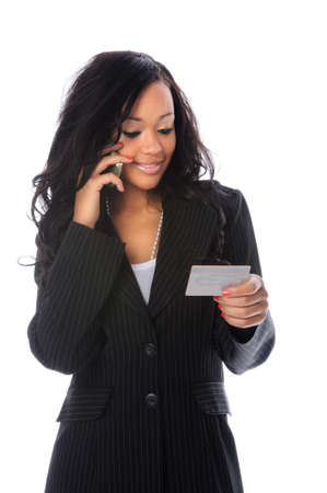 Businesswoman talking on the cell phone and holding a credit card Stock Photo - 7887471