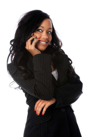 african american businesswoman: Beautiful African american woman talking on the cell phone Stock Photo
