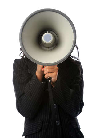 Businesswoman holding megaphone hiding her face