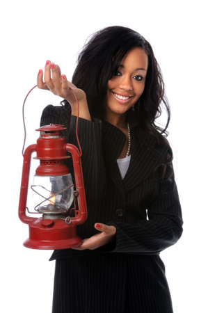 Beautiful African American woman holding oil lamp photo