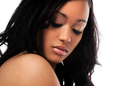 Beautiful young African American woman looking down photo