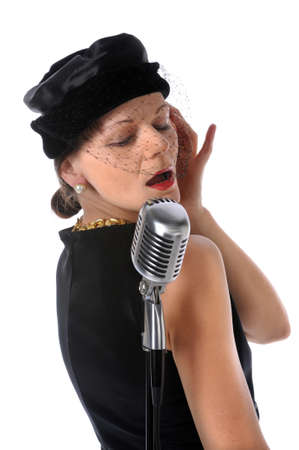 Retro singer singing into a vintage microphone photo