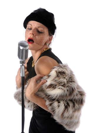 Retro singer singing into a retro microphone photo