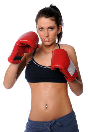 Young woman with boxing gloves isolated over a white background