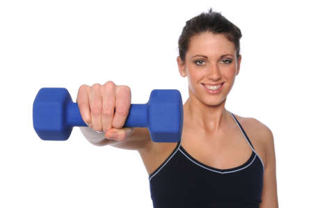 Young woman holding dumbell - With selective focus Stock Photo - 7887553