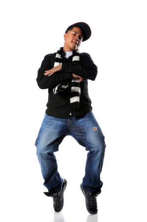 Young African american man performing hip-hop style dancing photo