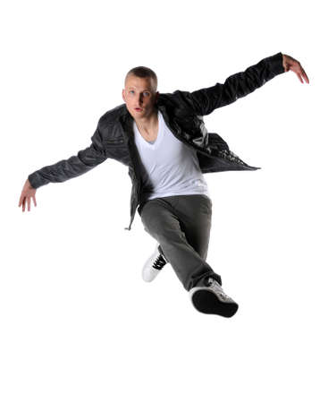Young hip hop dancer performing a jump isolated over a white background