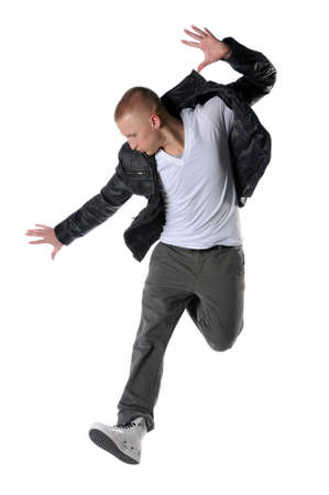 hip hop man: Hip hop style dancer performing a jump Stock Photo