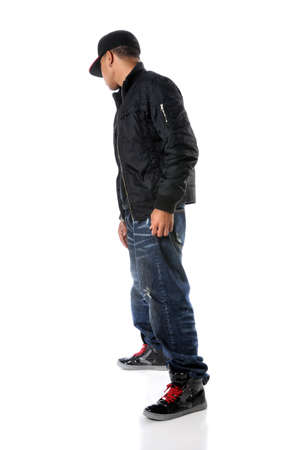 Hip hop young man standing isolated over a white background Stock Photo