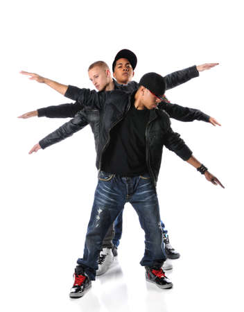 Three hip hop young men with arms stretched over a white background
