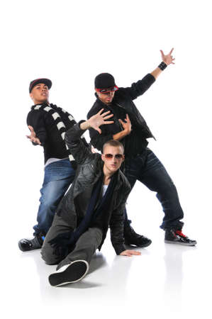 Hip Hop young men dancing isolated over a white background