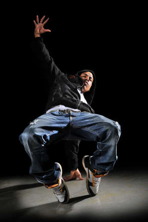 hip hop man: Hip hop man dancing over a dark background