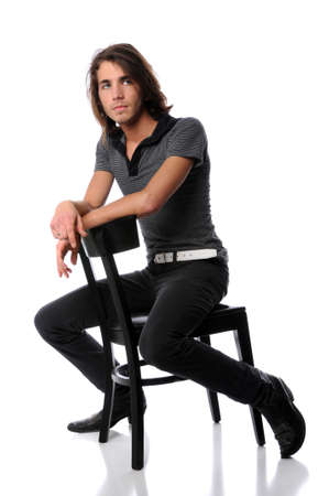 Young man sitting on black chair