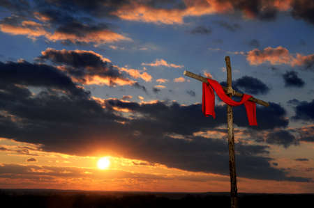redemption of the world: Cross with red tunic over a colorful landscape