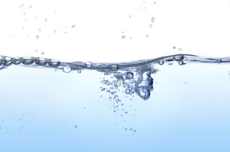 Water splashing forming bubbles over a white background