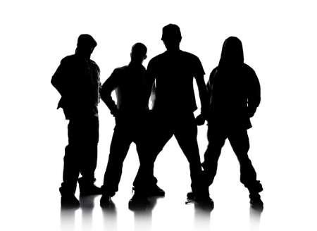raperos: Siluetas de los hombres de pie sobre un fondo blanco  Foto de archivo