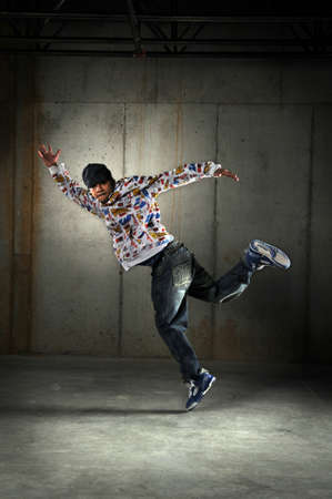 Hip hop African American dancing in an urban setting photo