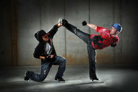 Hip hop men dancing performing a martial arts move