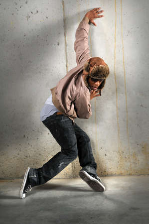 cool guy: African American hip hop dancer over a grunge background Stock Photo