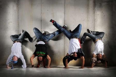 upside: Hip Hop men performing dance with handstand over grunge background