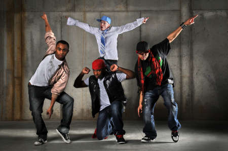 dancing pose: Hip hop men dancing over a grunge background