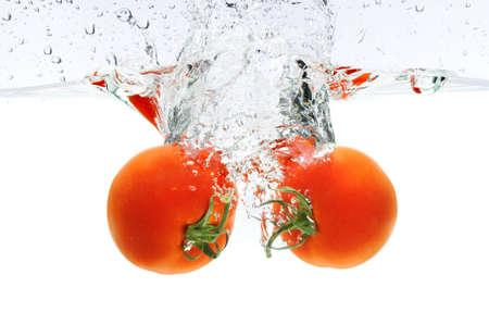 Red tomatoes splashing underwater