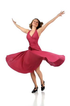 twirling: Beautiful dancer twirling dressed in pink dress over a white background Stock Photo