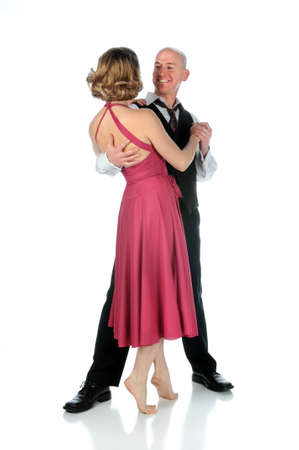 Man and woman dancing isolated over a white background photo