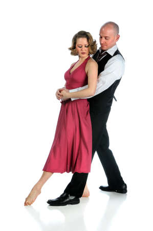 Couple dancing together isolated over a white background photo