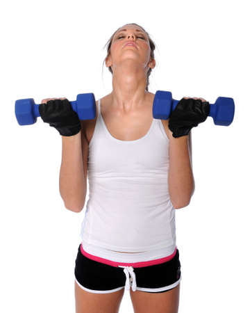 Young woman exercising with dumbbells isolated over white photo