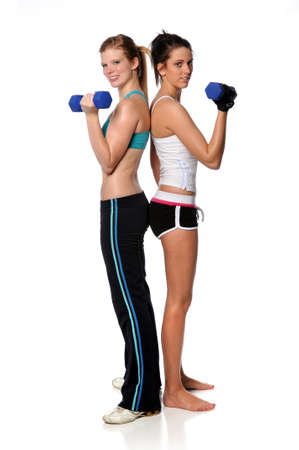 Young women curling dumbbell standing over white background photo