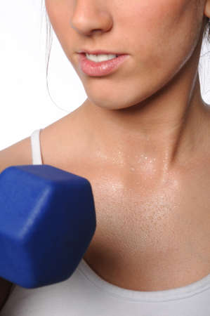Close up of woman exercising with dumbbell photo