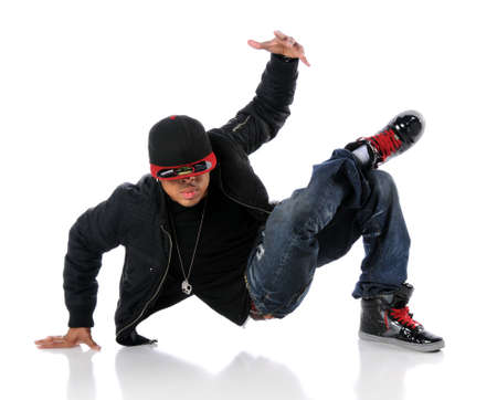 African American hip hop dancer performing over white background photo