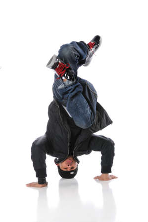 headstand: African American hip hop dancer performing headstand