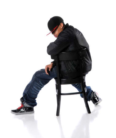 hip hop man: African American hip hop man sitting on chair Stock Photo