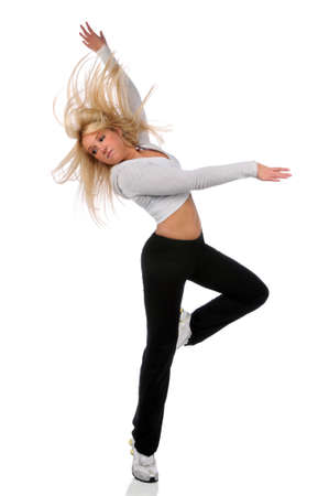 Young blond woman dancing over white background