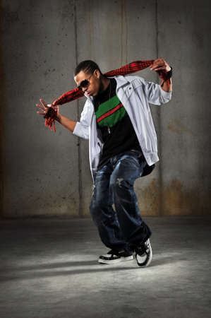 African American hip hop dancer performing over grunge background Stock Photo