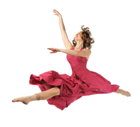 Beautiful dancer in red dress performing jump