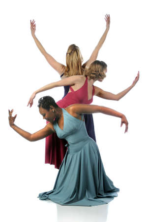 Beautiful dancers performing tofether over a white background