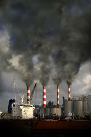 smokestacks: Industrial complex with smokestacks blowing pollution into the air