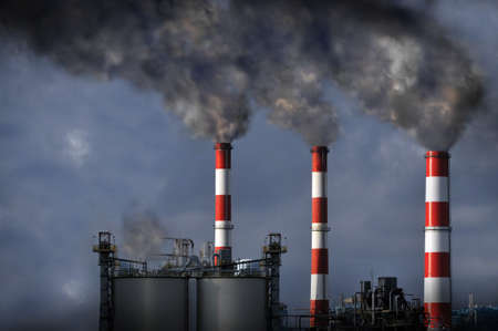 carbon emission: Industrial mokestacks blowing dark smoke into the atmosphere