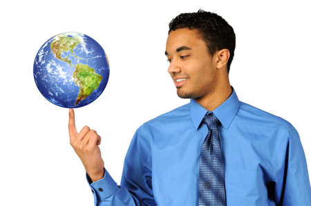 sphere: Young multiracial businessman balancing earth on tip of finger Stock Photo