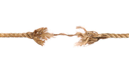 Frayed rope about to break isolated over white background photo